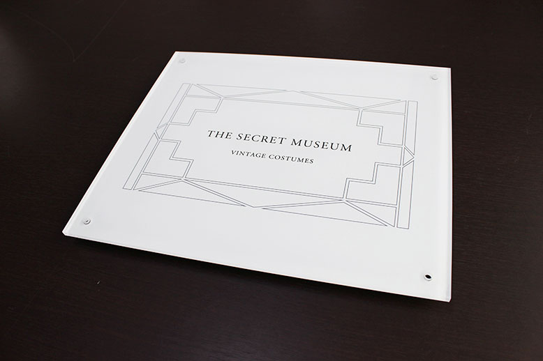 the secret museum sign